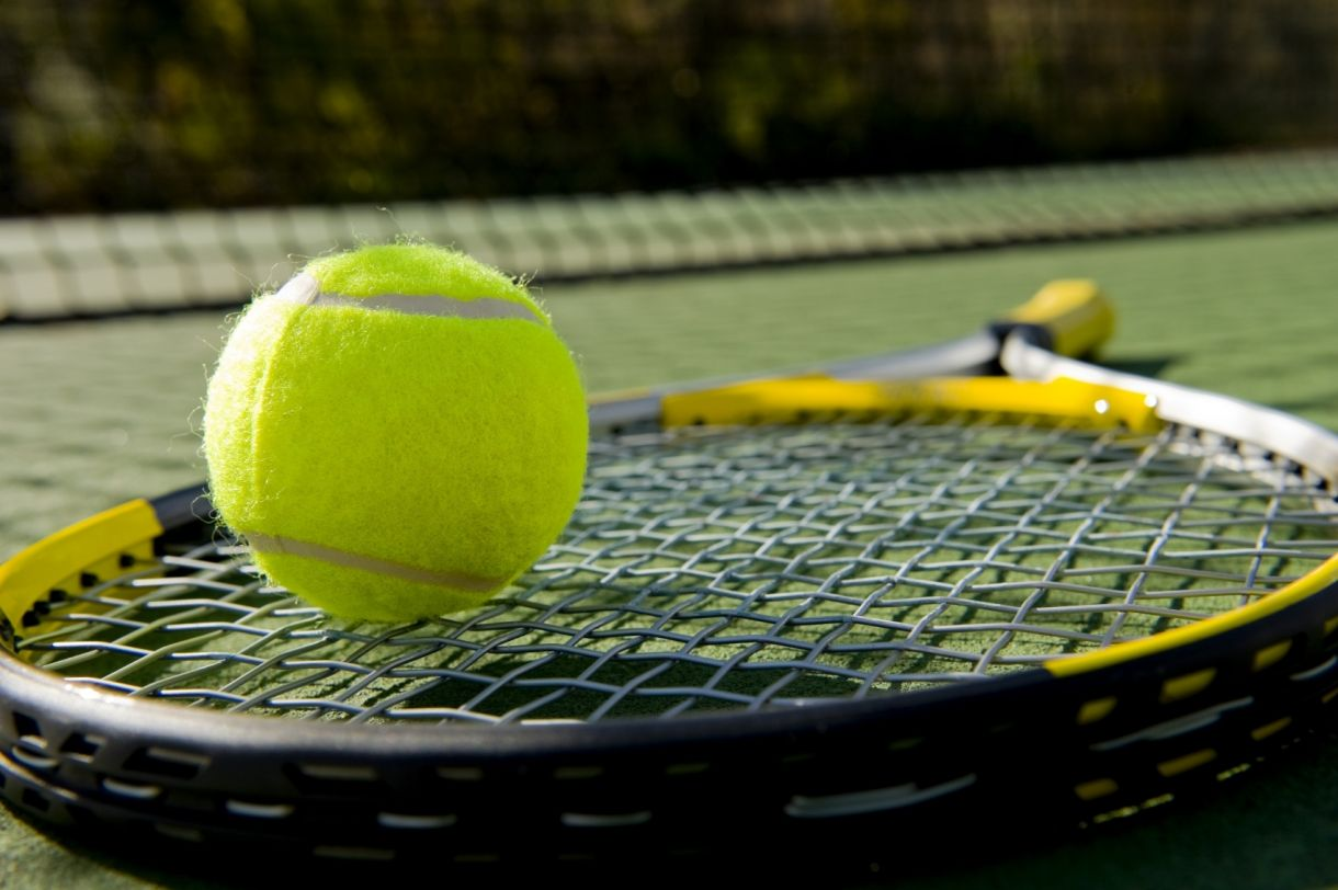 Tennis Equipment On Grass I Stock 000008765616 Medium