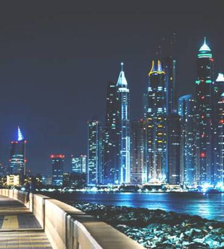 Dubai nighttime skyline. Discover Dubai Stag Party ideas below: