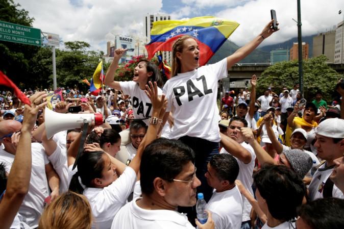 https://s3-eu-west-1.amazonaws.com/cdn.thepostinternazionale.it/files/uploads/venezuela-manifestazioni-maduro-orig_main.jpg