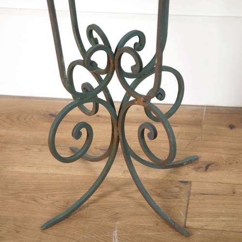 Decorative pair of stone and painted scroll iron tables