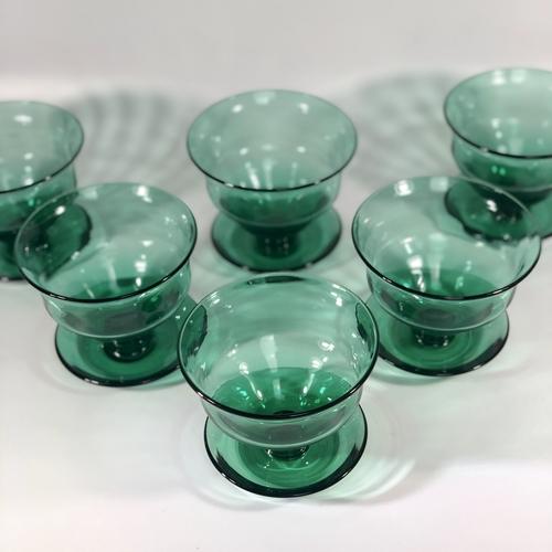 Six deep hand blown glass dessert bowls on stand