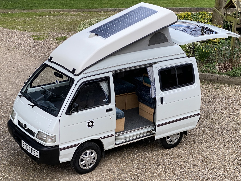 A Daihatsu camper with sliding doors.