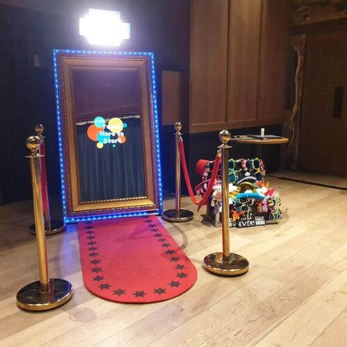 Magic Mirror Photo Booth with red carpet and props