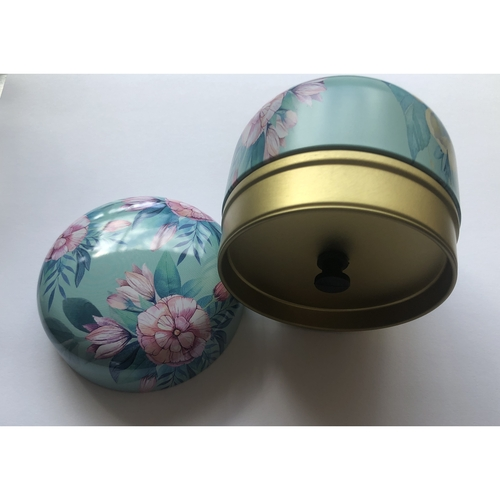 Small air-tight tea canister.