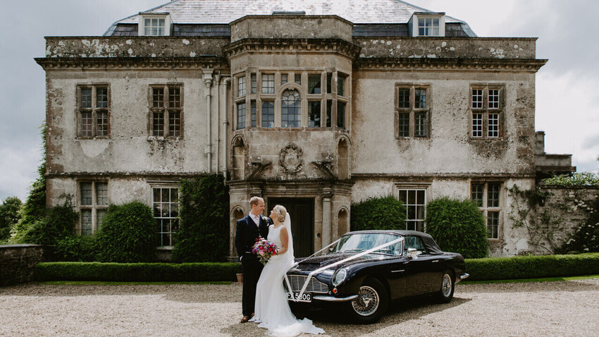 Wedding couple outside magnificent Hamswell House wedding venue