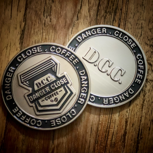 D.C.C. Two sided coin.