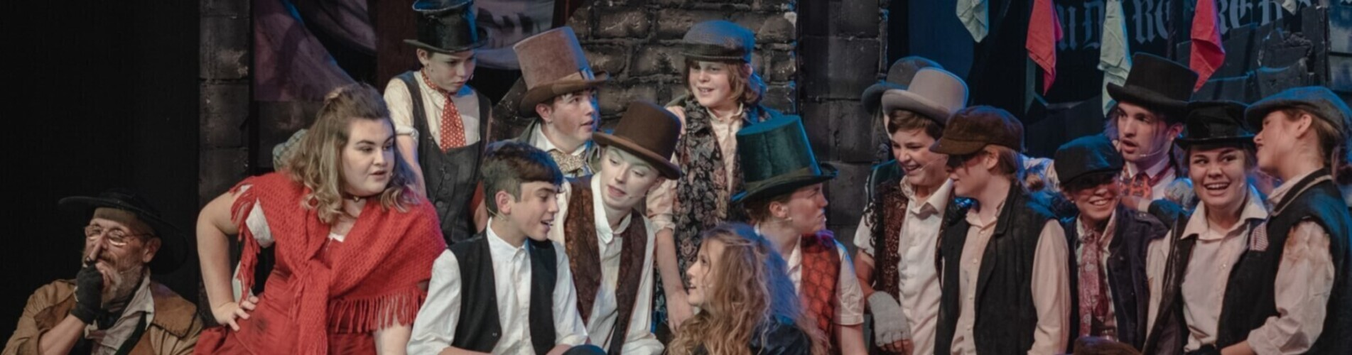 Youth drama group performing Oliver