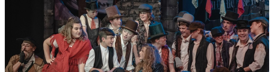 Our youth drama group performing the musical Oliver on stage
