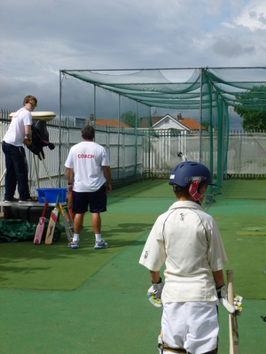 Student coach during  nets training, working with