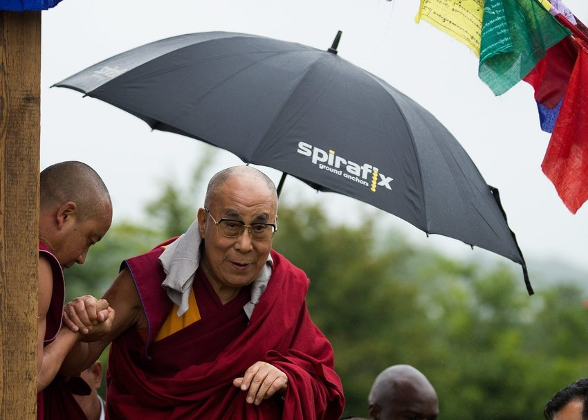 A Spirafix Ground Anchors umbrella being used by HHDL