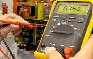 Engineer repairing an alarm system
