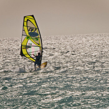 Yellow wind surfer