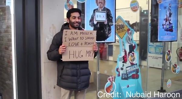 Meet The Muslim Guy Offering People Hugs To Spread Love Following Trump's Muslim Ban