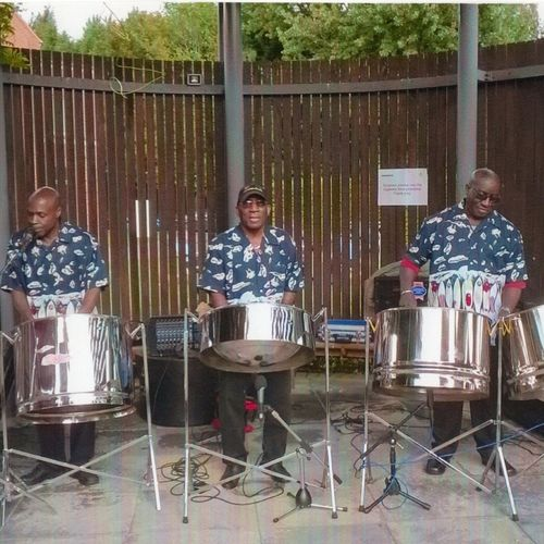 THE CARIBBEAN MELODY STEEL BAND