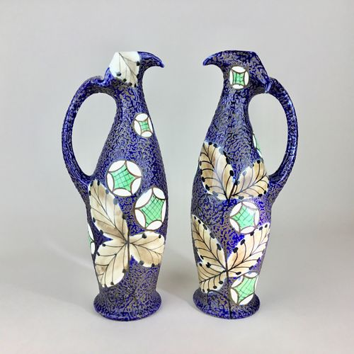 Exquisite pair of Art Nouveau Amphora enamelled jugs
