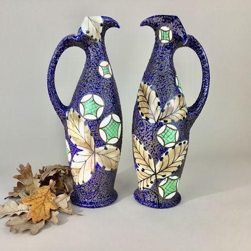 Exquisite pair of Art Nouveau Amphora enamelled jugs