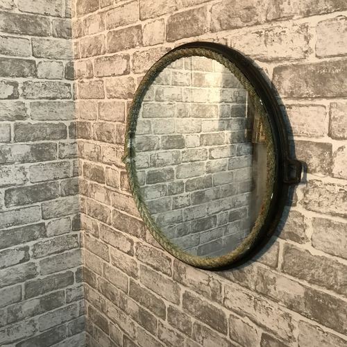 Upcycled Manhole Cover Mirror.