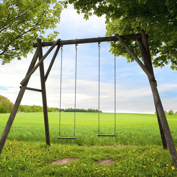 How do you safely secure children's outdoor play equipment?