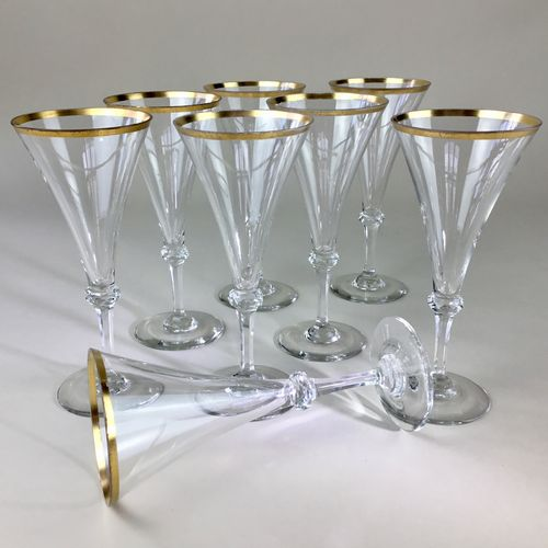 Eight 19th Century gold rimmed champagne flutes