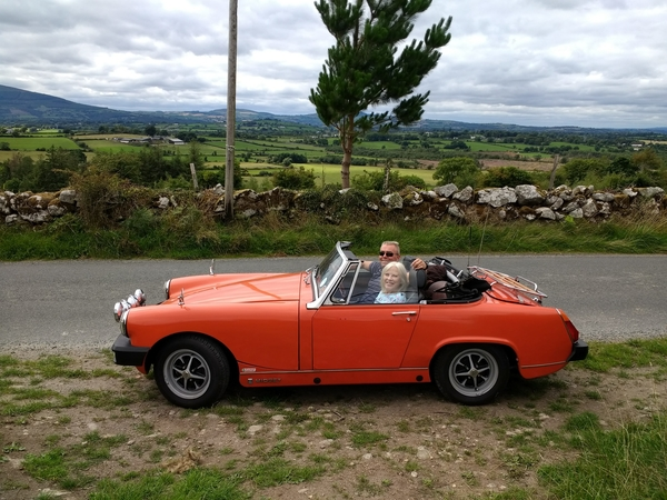 Our MG Midget and us, in Ireland