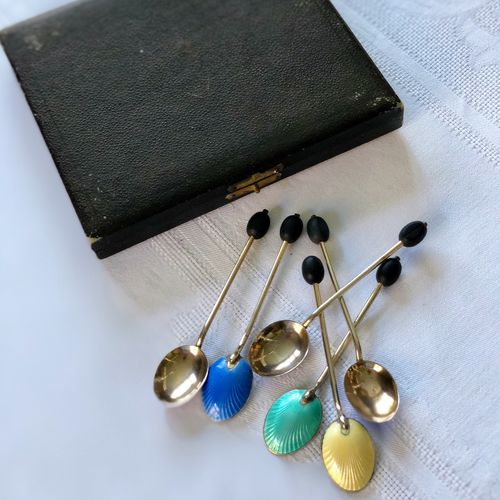 A set of Art Deco Guilloche enamel gilded coffee bean spoons