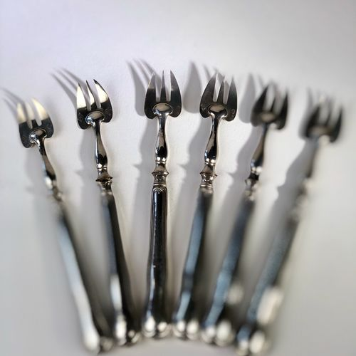 Set of antique French silver oyster forks