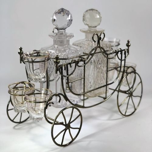 Unusual 'Carriage' decanter and shot glasses holder