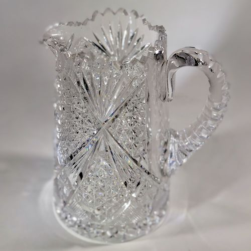 Splendid quality heavily cut glass English water jug.