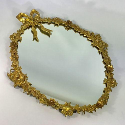 Pretty gilded metal oval wall mirror Circa 1930