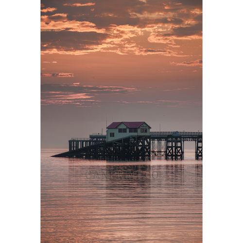 Pink sky and calm sea at Mumbles