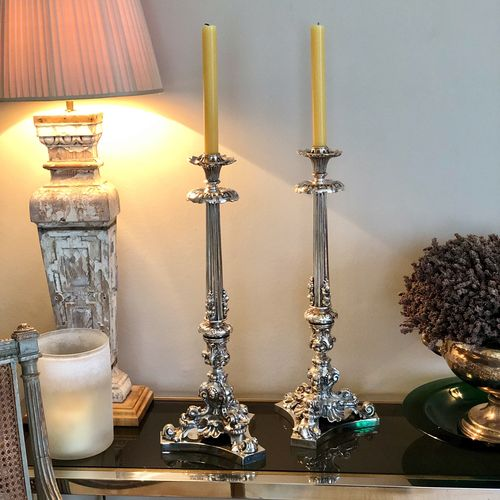 Striking pair of tall Victorian silver plated candlesticks