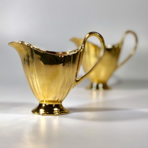 Pair of Royal Worcester gold lustre jugs