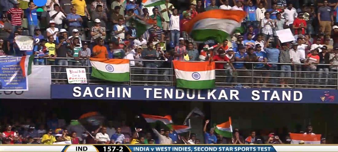 Indian cricket fans waving flags in the Sachin Tendulkar Stand