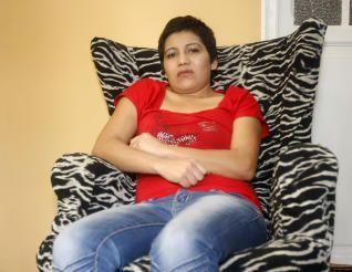 la hondureña María Concepción con camiseta roja