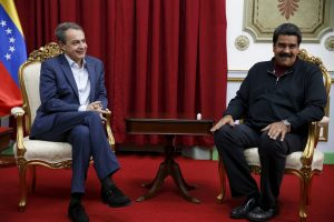 Venezuela's President Nicolas Maduro (R) and former Spanish prime minister Jose Luis Rodriguez Zapatero smile while they talk during their meeting at Miraflores Palace in Caracas