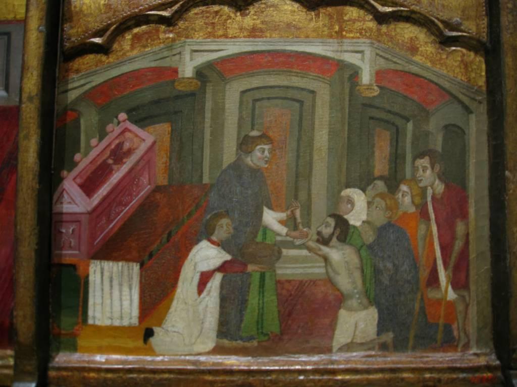 Retablo de San Antonio (fragmento) en el que puede verse un fraile antoniano atendiendo a los enfermos del fuego de San Antonio. MNAC (Barcelona)