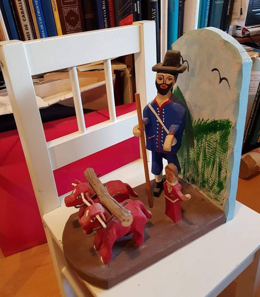 San Isidro con su hijo y los dos bueyes arando