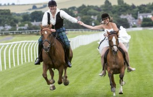 Article in the Daily Mail:  Major Chris Baird-Clark and bride Shelley got married life off to a winning start with a gallop at Musselburgh Racecourse. The Major was astride his chestnut Irish Draught, Rosie, while Shelley rode her bay coloured Arab, Mimi. Pic shows: Chris and Shelley