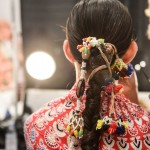Fishtail braids with beading and tassles