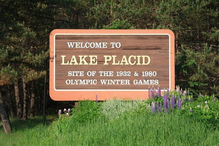 Welcome to Lake Placid highway road sign trees grass