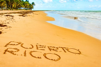 Puerto Rico written on one of its beautiful beaches