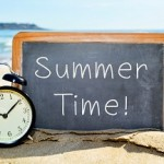 alarm clock and chalkboard with the text summer time