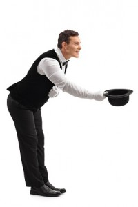 Waiter bow down and taking off his hat