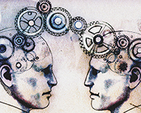 Two men's heads face to face connected by cogs. Image shot 2012. Exact date unknown.