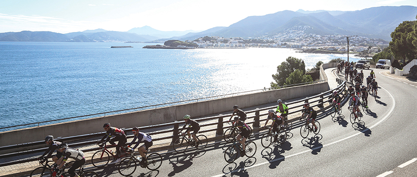 Cyclists by the coast