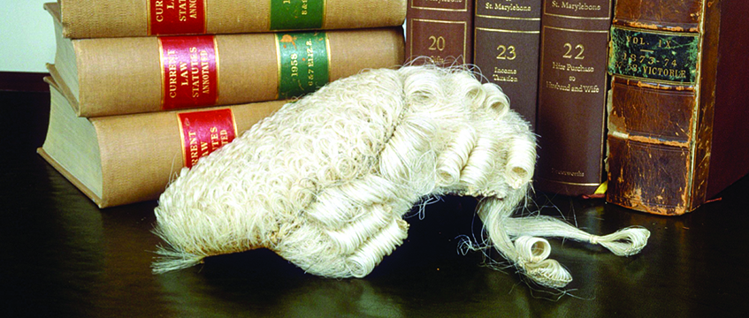 Judges' wig, legal books. Photo: John Curtis/REX/Shutterstock