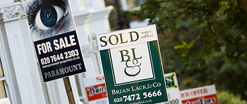 Residential for sale signs. Photo: Tim Graham/Robert Harding/Shutterstock