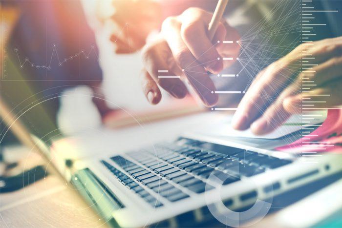 Typing on laptop - close up