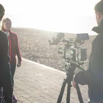 A film crew with an actress on Brighton beach