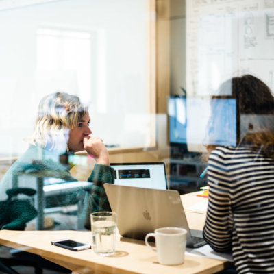 Two women discussing wireframes